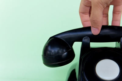 Hand reaching for telephone receiver