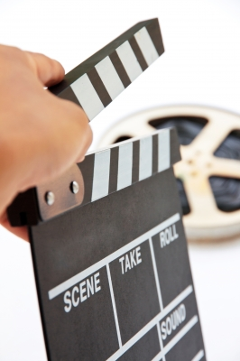 Hand Holding Clapper Board