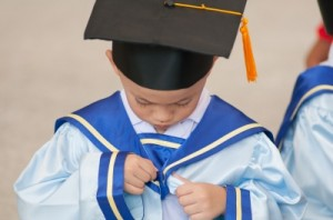 Small boy graduates from a video game degree school.