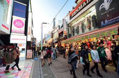 Video game developers walking through a Japanese city