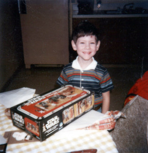 Little Jason opens a Star Wars play set for his birthday.