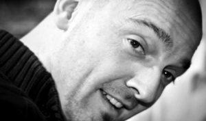Profile photo of John Dennis, video game designer writer